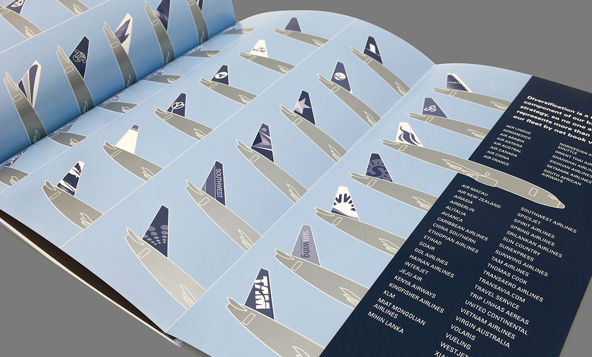 Corporate report design of airplane tail graphics on interior spread.