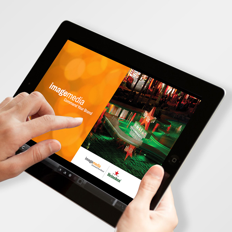 Branding and website design applied to a marketing presentation on an iPAD.