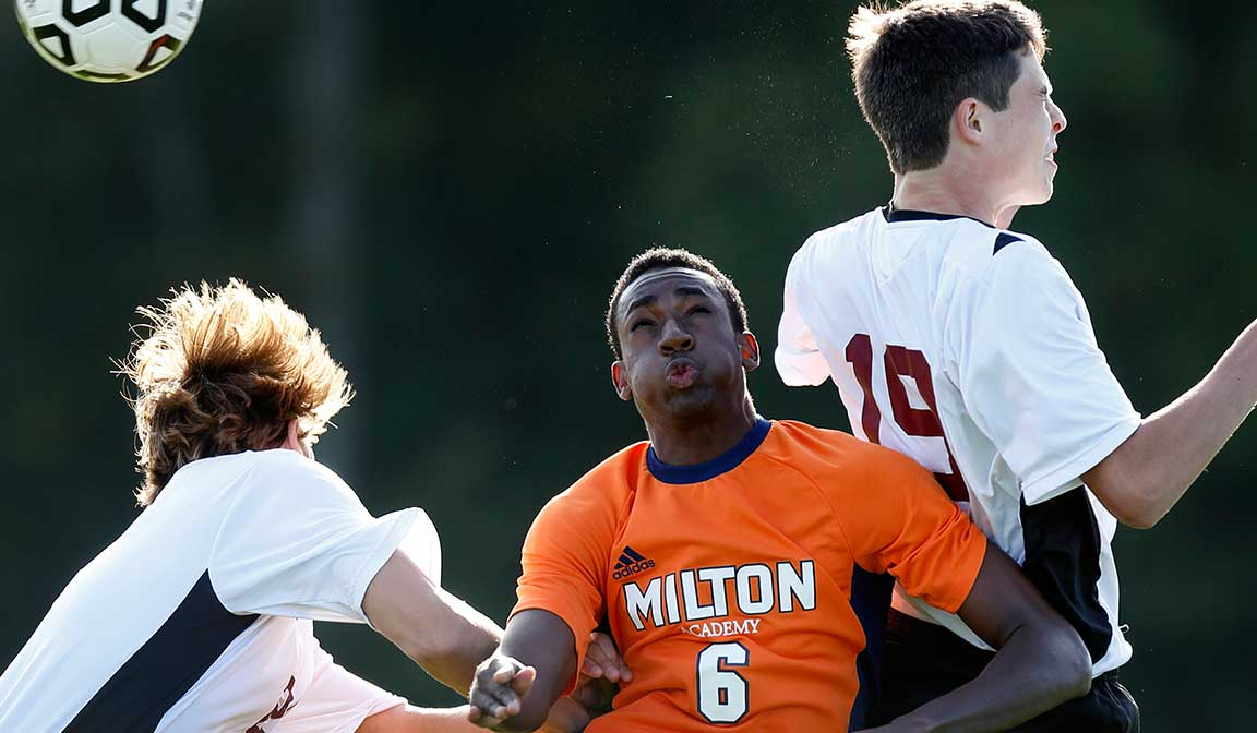 Milton Mustang sports branding on men's soccer uniforms of young athletes.