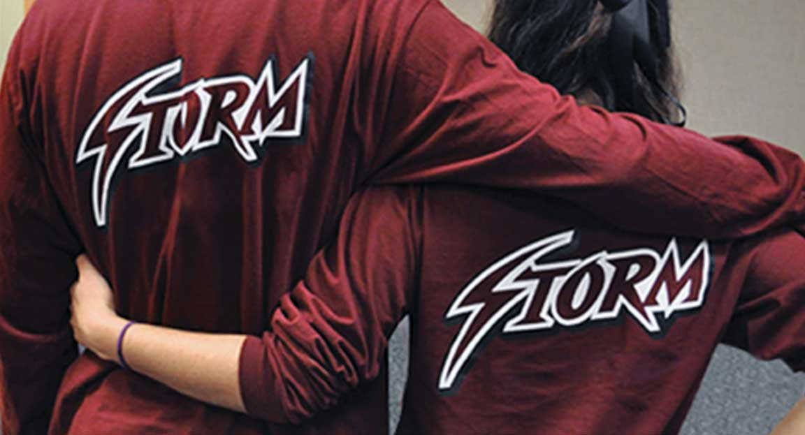 The Storm logo created for the sports branding of St. Luke's School's varsity teams applied to the back of shirts.
