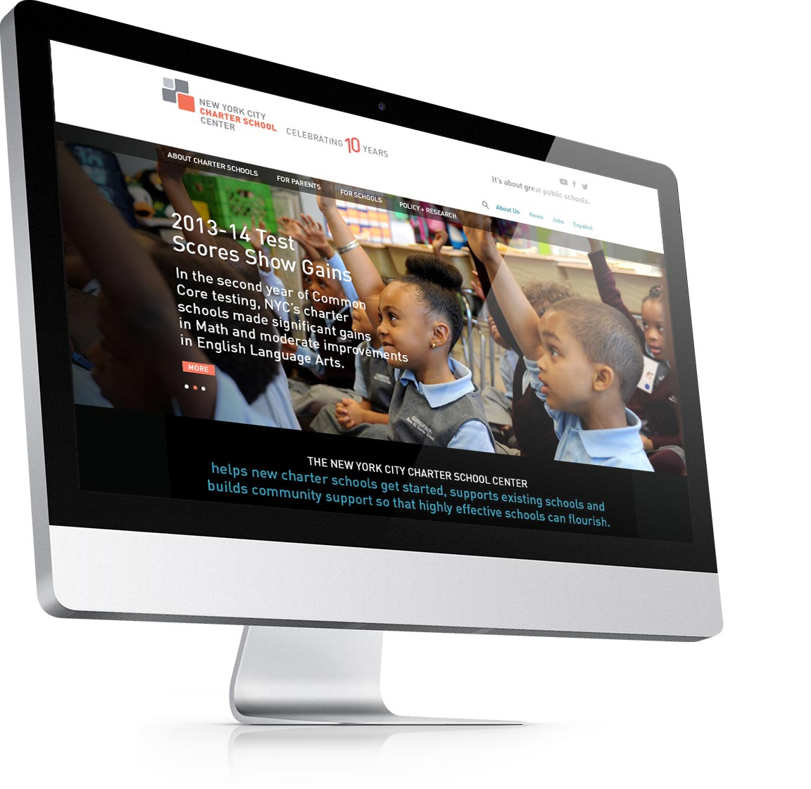 Design of the homepage for the nonprofit website NY City Charter School Center seen on an iMAC.