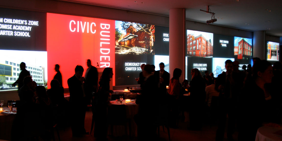 Civic Builders visual identity and design wall graphics projected during a fundraising event.