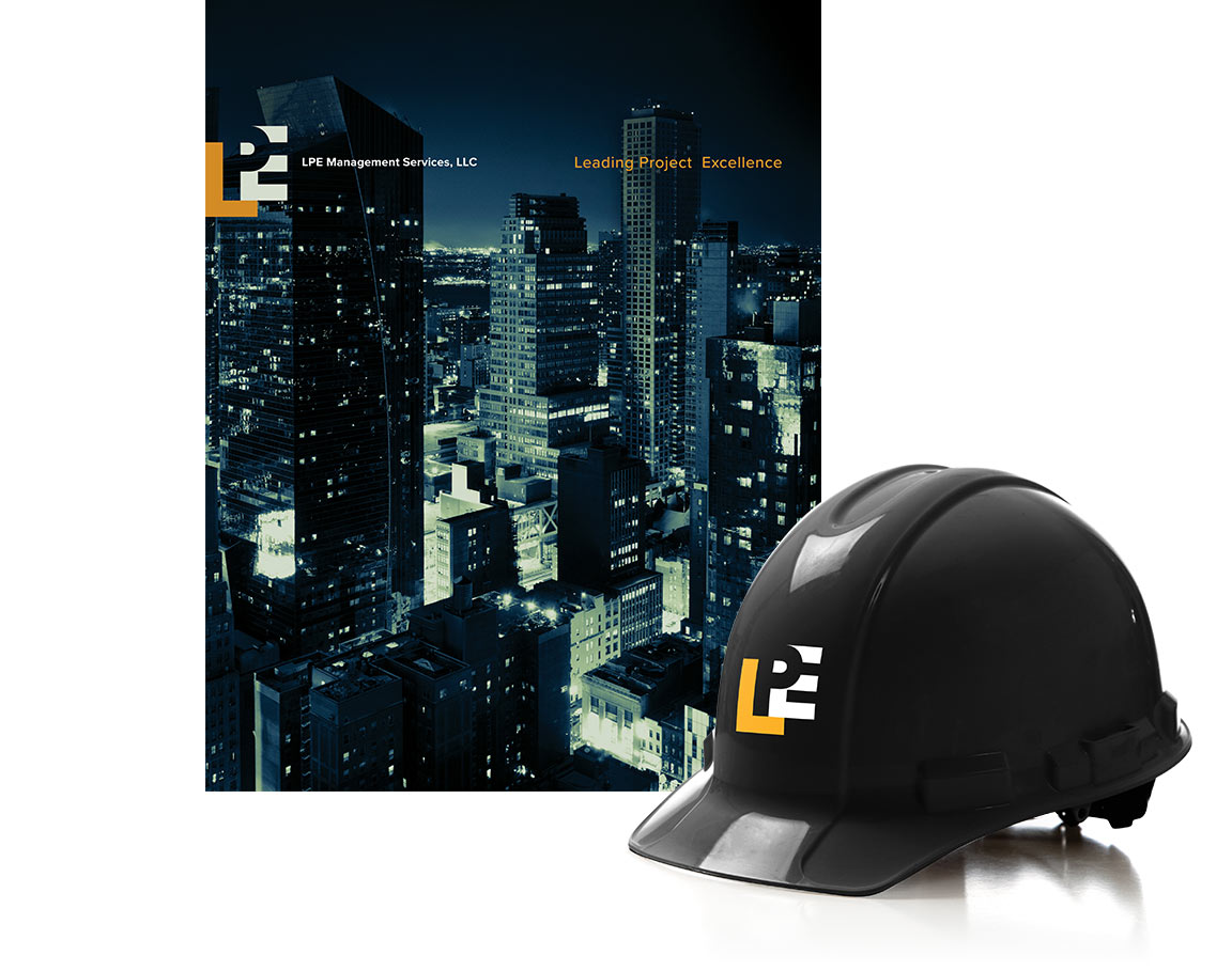The LPE Management Services brand identity designed by Bernhardt Fudyma Design Group NY applied to a marketing capabilities brochure and hard hat